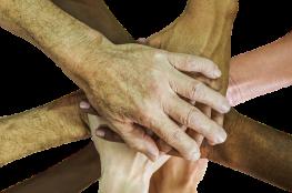 putting hands together - diversity